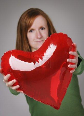 Woman Giving Heart