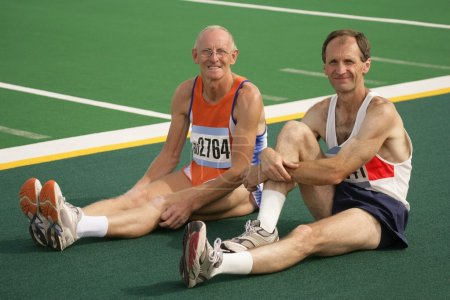 Two Athletes Resting At The Track