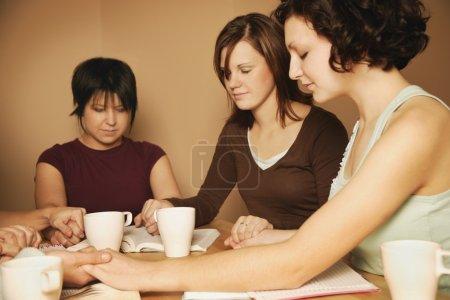 Teenagers Praying Together