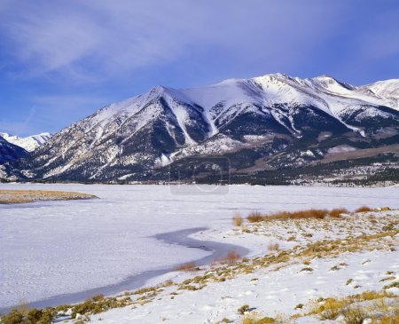 A Frozen Lake In The Rocky Mountains