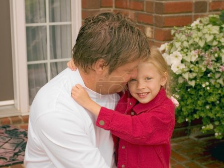 Daughter Hugs Father
