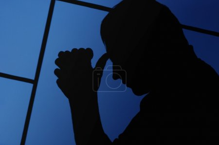 Silhouette Of A Man Praying
