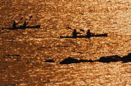 People Kayak On The Water