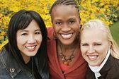 Multiethnic Portrait Of Three Women Outdoors