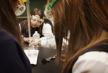 Students Working In A Science Lab