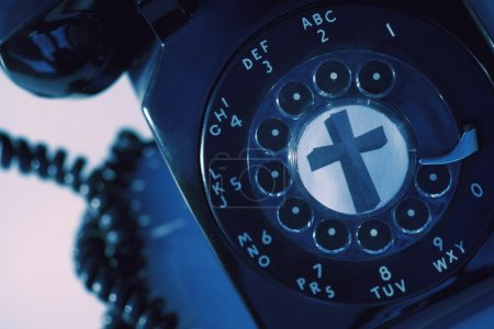 A Rotary Phone With A Cross