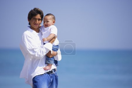 Father And Infant On Beach