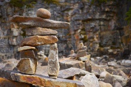 Stone Figure Among Many Rocks
