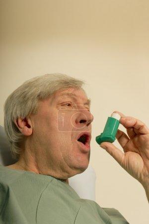 Man Holding An Inhaler