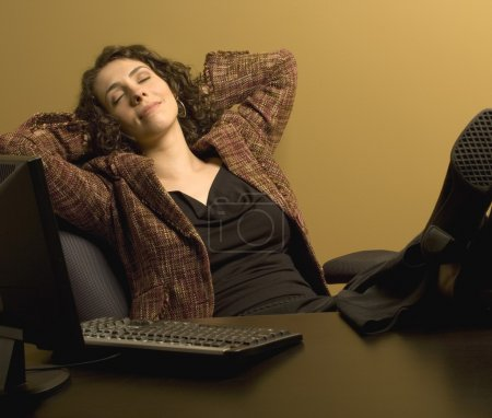 Photo for Woman Resting At Her Desk - Royalty Free Image