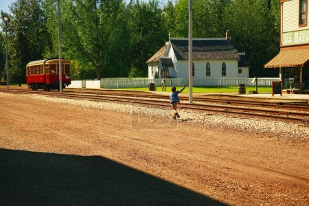 Fort Edmonton Park, Alberta, Boy Waving At Trolley