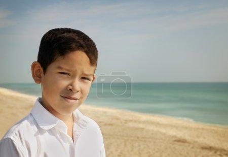 Portrait Of A Boy On A Beach