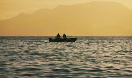 People Fishing At Sunrise