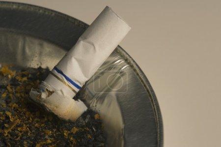 Cigarette Butt In Ashtray Receptacle