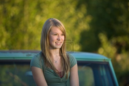 Teenage Girl Leaning Against Vehicle