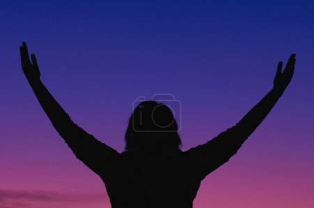 Photo for Silhouette Of A Woman Worshipping In Nature - Royalty Free Image