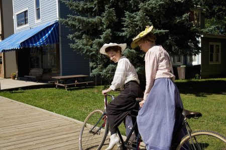 Women Riding A Tandem Bicycle