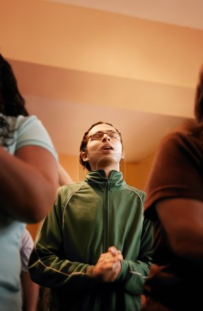 Young Man In Prayer Service
