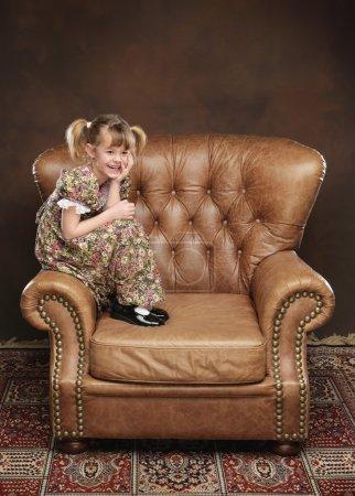 Girl Sitting In Armchair