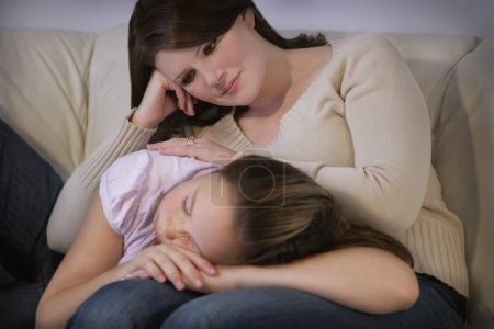 Mother Watches Tenderly Over Daughter