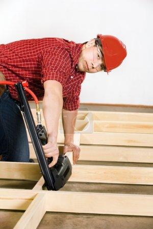 Carpenter Working With Nail Gun