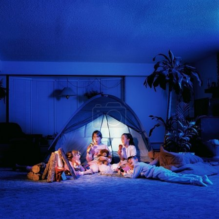Children Playing Under A Tent In The Living Room