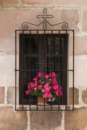 Window With Flowers And Cross, Carmona, Cantabria, Northern Spain