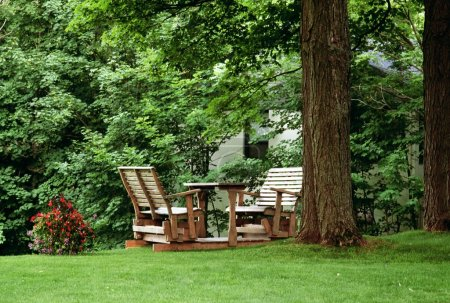 Wooden Chairs Set Up In A Yard