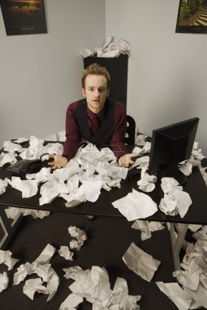 Man In Messy Office