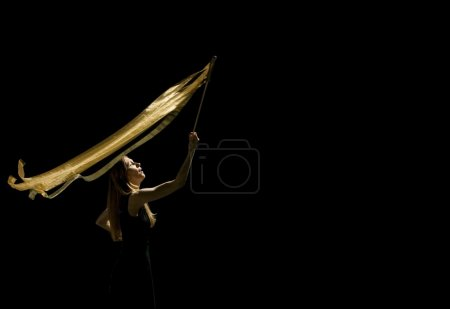 Woman Waving Flag In Black Background