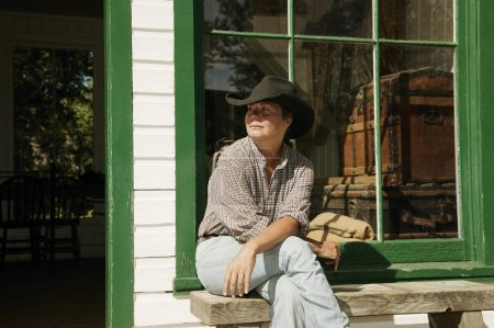 Woman Sitting In Front Of A Store In Fort Edmonton, Alberta