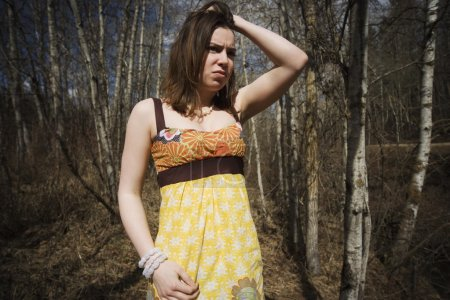 Troubled Woman In Wooded Area