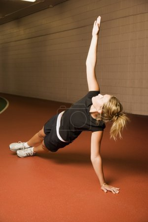 Side View Of A Woman Doing Exercise