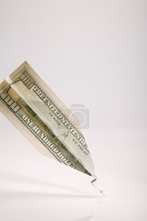 One Hundred American Dollar Bill Folded Into Paper Airplane