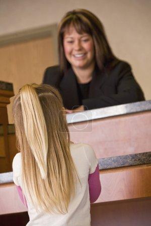 Girl At Service Desk