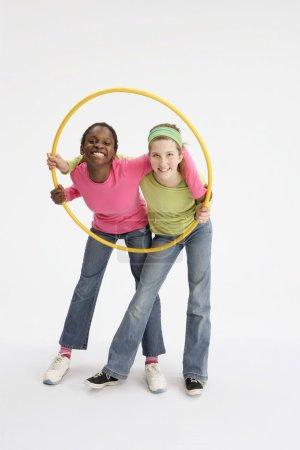 Girls Holding Yellow Hula Hoop