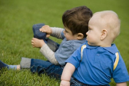 Two Boys Sitting On Grass