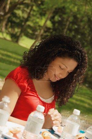 Woman Praying At Mealtime