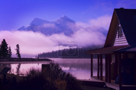Cabin Boathouse And Foggy Sunrise Over Mountain Lake