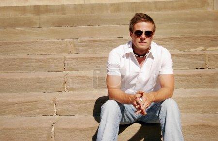 Guy Sitting On Steps