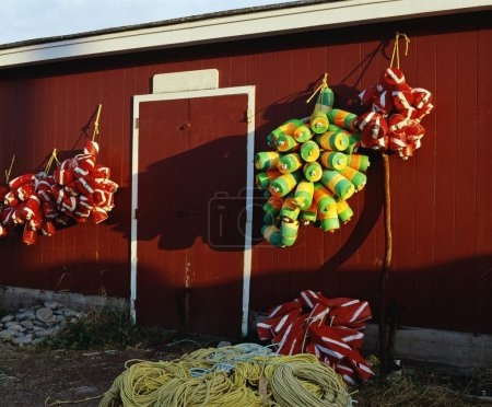 Fishing Buoys Hanging On An Outside Wall