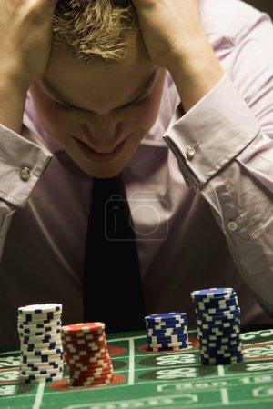 Man Loosing At Gambling