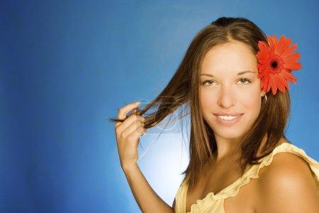 Brunette Model With Flower In Her Hair