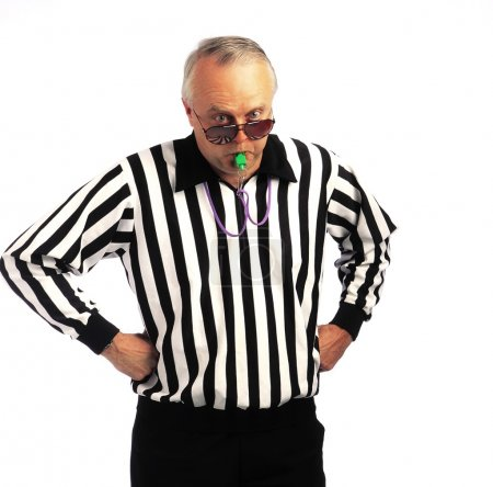 Referee With Hands On Hips Blowing A Whistle