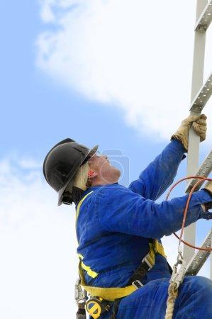 Industry Worker Climbing A Ladder