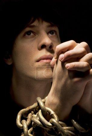 Man In Chains, Praying