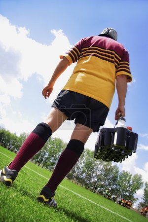 Rugby Player On The Sideline With Refreshments