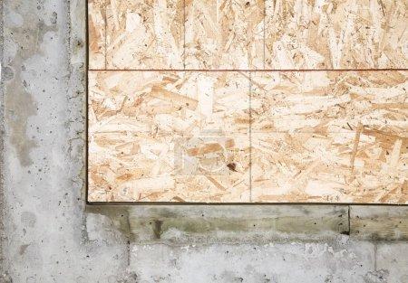 Corner Piece Of Wood Encased In Concrete