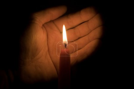 Hand And Candle