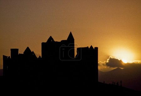 Cashel Rock,Co Tipperary,Ireland. Cashel Rock Silhouetted Against Majestic Sunset